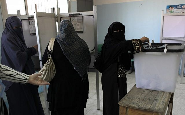 Egyptian women vote Saturday at a polling station in Cairo. (photo credit: Nasser Nasser/AP)