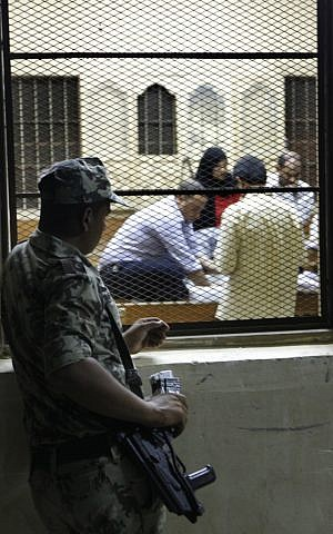 A soldier watches ballot counting in Cairo, June 17 (photo credit: AP Photo/Amr Nabil)