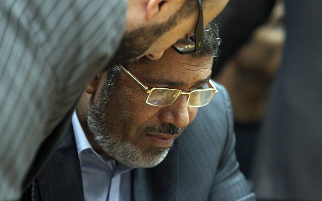 Muslim Brotherhood presidential candidate Mohammed Morsi confers with an aide during a meeting with relatives of those killed and injured during last year's revolution (AP Photo/Ahmed Gomaa)