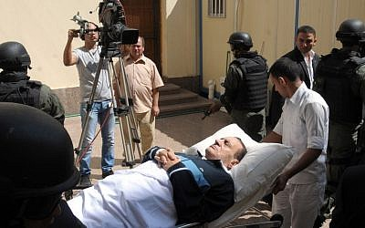 Former Egyptian president Hosni Mubarak is taken to court for a session in his trial in Cairo in September 2011. (photo credit: AP/Mohammed al-Law)
