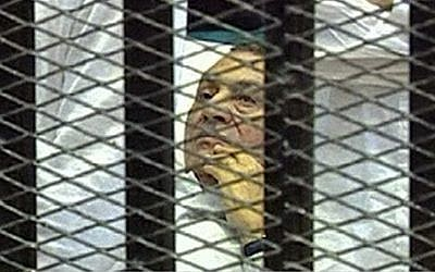 Hosni Mubarak on the first day of his trial in Cairo (photo credit: AP photo)