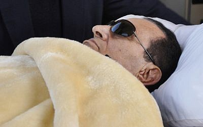 Hosni Mubarak lying down in court in January. (photo credit: AP/Mohammed al-Law)