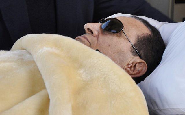 Hosni Mubarak lying down in court in January. (photo credit: AP/Mohammed al-Law)