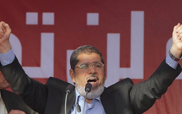 Egypt's President-elect Mohammed Morsi talks to his supporters at Tahrir Square, the focal point of Egyptian uprising. (photo credit: AP)