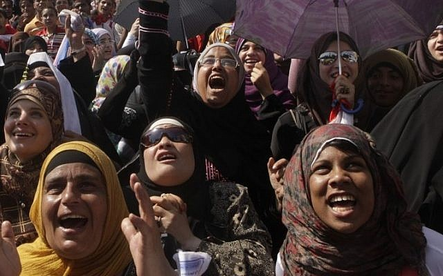 Egyptian women shout slogans at a protest in Tahrir Square, Cairo, Friday.