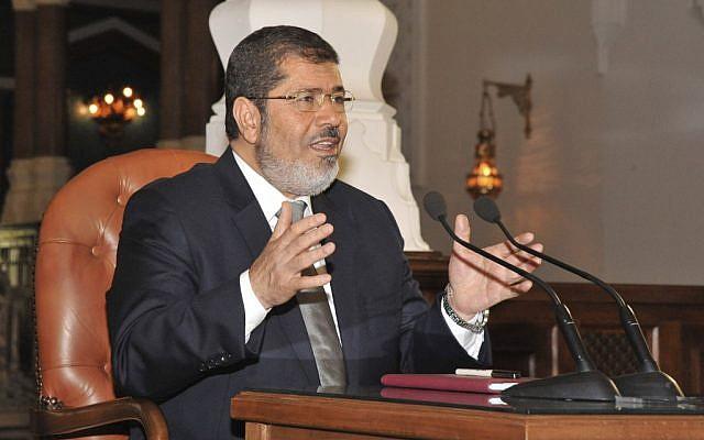 Egyptian President-elect Mohammed Morsi speaks to newspaper editors in Cairo on Thursday, June 28, 2012. (photo credit: Egyptian Presidency/AP)