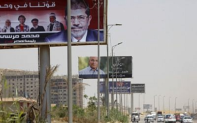 Billboards in Cairo feature presidential candidates Ahmad Shafiq and Muhammad Mursi (photo credit: AP Photo/Amr Nabil)