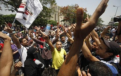 Egyptians protest the court decision in Cairo Thursday (photo credit: AP Photo/Amr Nabil)