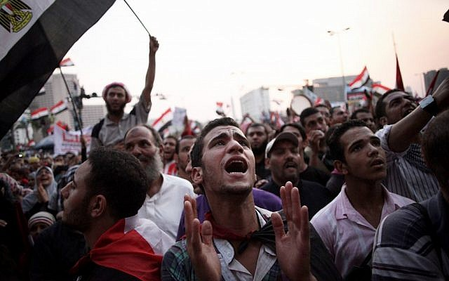 Egyptian protesters in Cairo's Tahrir Square Saturday (photo credit: AP Photo/Manu Brabo)