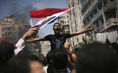 An Egyptian protester chants slogans against presidential candidate Ahmed Safiq during a demonstration against the Supreme Constitutional Court rulings in Alexandria, Egypt. (photo credit: AP)