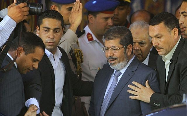 Egypt's new president, Mohammed Morsi (center), leaves Friday prayers at Al-Azhar mosque in Cairo last month (photo credit: Amr Nabil/AP)