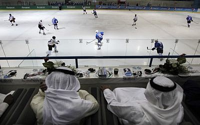 Emirati and Kuwaiti officials watch a hockey match between Oman and Kuwait in Abu Dhabi, United Arab Emirates (photo credit: AP/Kamran Jebreili)