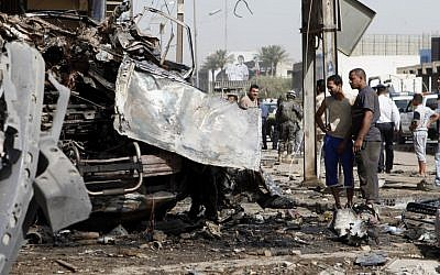 The scene of a car bomb attack in the Karrada neighborhood of Baghdad, June 13 (photo credit: AP Photo/Karim Kadim)