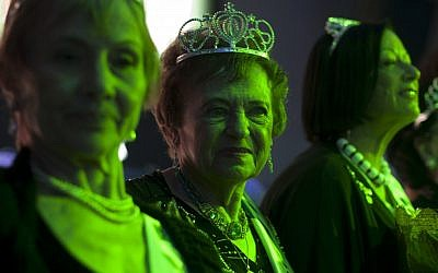 Holocaust survivors participate in a beauty pageant in Haifa on Thursday, June 28, 2012. (photo credit: Sebastian Scheiner/AP)