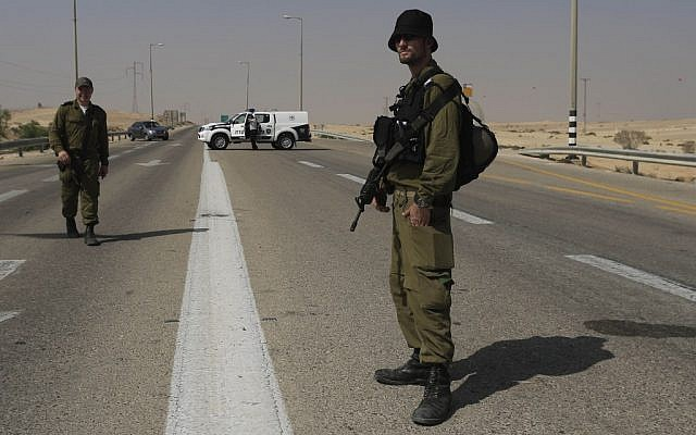 Israeli troops guarding the area near the attack. (photo credit: AP/Tsafrir Abayov)
