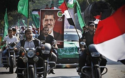 Palestinians rally along the streets of Gaza City to support Muslim Brotherhood candidate Mohammed Morsi on Monday (photo credit: AP/Adel Hana)
