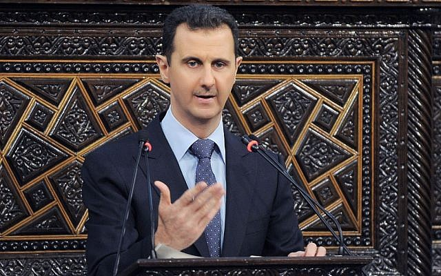 Syrian President Bashar Assad delivering a speech at the parliament in Damascus (photo credit: AP/SANA)