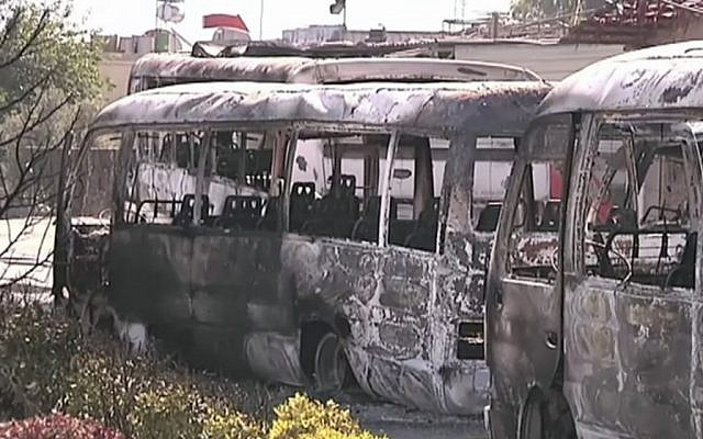 This image made from video released by the UN observer mission in Syria and accessed in June 2012 purports to show destroyed buses after fighting in Damascus, Syria. (photo credit: UNSMIS via AP video)
