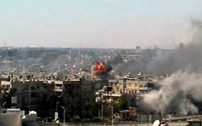 A series of explosions rocked the central Syrian city of Homs on June 13. (photo credit: Bambuser/Homslive/AP)