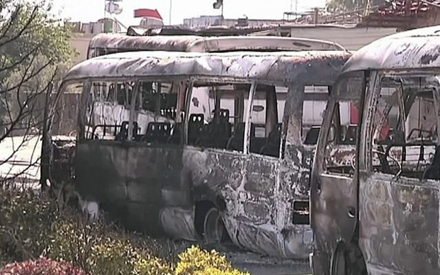 Destroyed buses after overnight fighting in Damascus in June (photo credit: AP/UNSMIS)