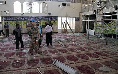 UN observers in a suburb of Damascus inspect the prayer hall of the Sayyida Zeinab shrine after it was damaged by a car bomb on Thursday. (photo credit: Bassem Tellawi/AP)