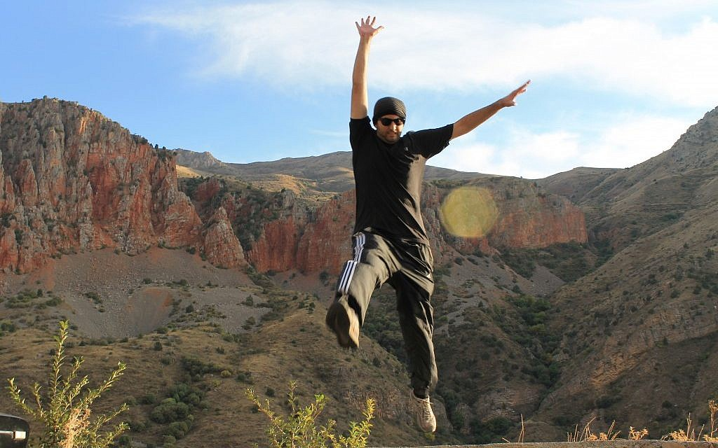 Mykil Bachoian jumps for joy in Armenia. He's also explored his roots in Israel. (photo credit: Courtesy/JTA)