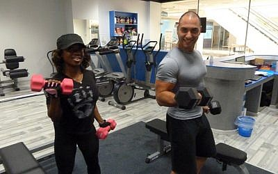 Sky Gym client Alana Shipp and Meny Elbaz in training (photo credit: Dani Bronstein)