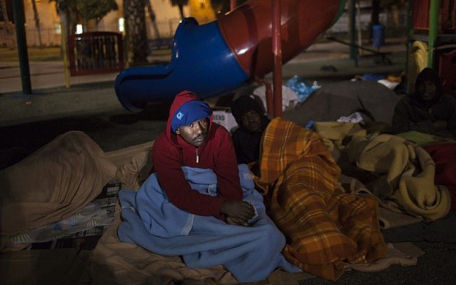 Homeless men sleep outside in Levinsky Park, Tel Aviv. (photo credit: Tamir Kalifa)