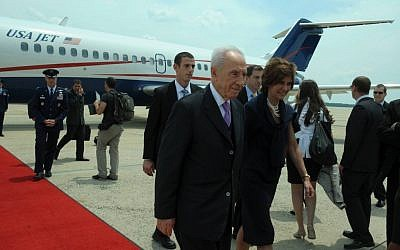 Israeli President Shimon Peres arriving in Washington, DC, where he will be awarded the US Presidential Medal of Freedom (photo credit: Courtesy Amos Ben Gershom/GPO)
