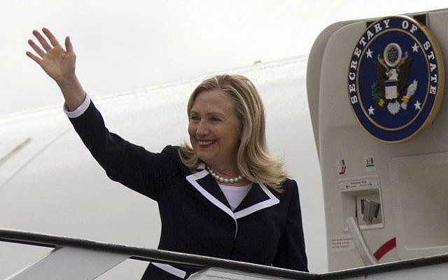US Secretary of State Hillary Clinton waves before boarding a plane in Riga, Latvia on Thursday. (photo credit: AP/Haraz N. Ghanbari)