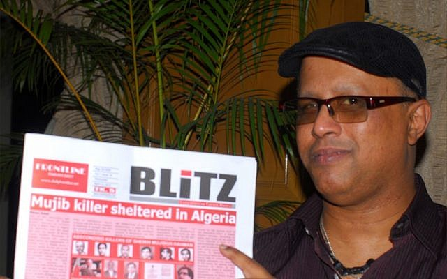 Salah Uddin Shoaib Choudhury holding the English-language Weekly Blitz. (Larry Luxner)
