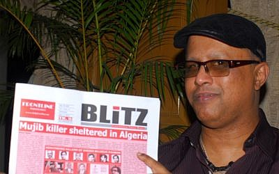 Salah Uddin Shoaib Choudhury holding the English-language Weekly Blitz. (photo credit: Larry Luxner/JTA)