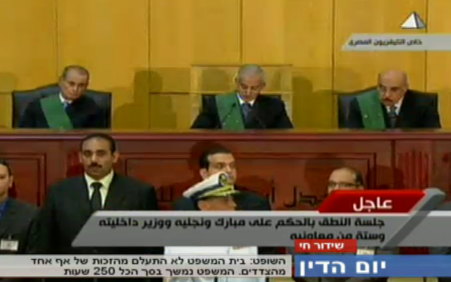 Image capture from Egyptian state television of Judge Ahmed Rifaat handing down former Egyptian president Hosni Mubarak's life sentence.