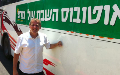 MK Nitzan Horowitz (Meretz) by a Meretz-sponsored free bus Saturday. Residents took the buses from Kfar Saba to the beach in Herzliya. (photo credit: courtesy, Nitzan Horowitz/Facebook page)