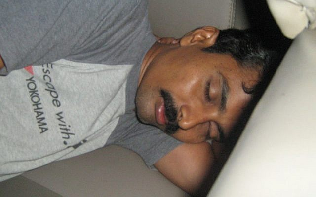 Illustrative photo of a man sleeping (CC-BY-SA 3.0, Wikimedia Commons)