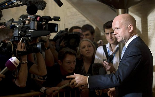 British Foreign Minister William Hague, right, talks to media representatives upon his arrival for a meeting of the Action Group for Syria at the European headquarters of the United Nations. (photo credit: AP)