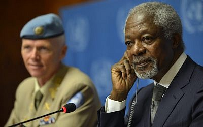 Kofi Annan, right, Joint Special Envoy of the United Nations and the Arab League for Syria, next to Major-General Robert Mood, left, head of the UN Supervision Mission in Syria and Chief Military Observer during a press briefing at the United Nations in Geneva, Switzerland, Friday (photo credit: AP/Keystone, Martial Trezzini)