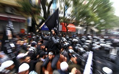 Tunisian Salafists confront police officers during a demonstration in Tunis in February. (photo credit: AP/Amine Landoulsi, File)