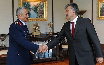 Turkish President Abdullah Gul, right, shakes hands with Gen. Mehmet Erten, Commander of the Turkish Air Force, in Istanbul Turkey, Monday, June 25, 2012. (photo credit: AP/Mustafa Oztartan, Turkish Presidency Press Office, HO)