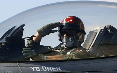 A Turkish pilot salutes before take-off at an air base in Konya, Turkey (photo credit: AP)