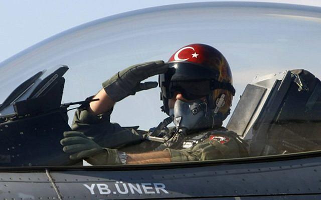 A Turkish pilot salutes before take-off at an air base in Konya, Turkey (photo credit: AP)
