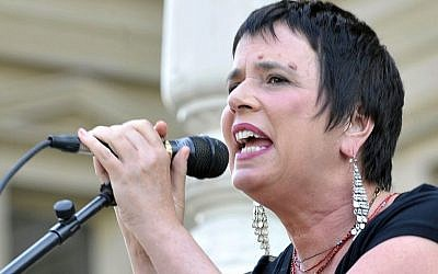 Eve Ensler, author of 'The Vagina Monologues,' speaks on June 18, 2012 during a performance of her play by Democratic state Rep. Lisa Brown, 10 other lawmakers and several actresses on the Michigan Statehouse steps. (photo credit: AP Photo/Detroit News, Dale G. Young)
