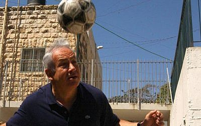 Benjamin Netanyahu dribbles a soccer ball on his head during a light moment in 2012. (photo credit: Yossi Zamir/Flash90)