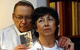 Miriam and Yoni Baumel in 2003 holding a picture of their son Zachary, who has been missing in action since 1982. (Flash90)