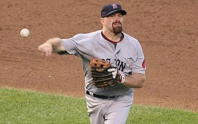 Boston Red Sox third baseman Kevin Youkilis makes a throw in a game against the Baltimore Orioles, August 2009. (photo credit: Keith Allison, CC, via wikipedia)