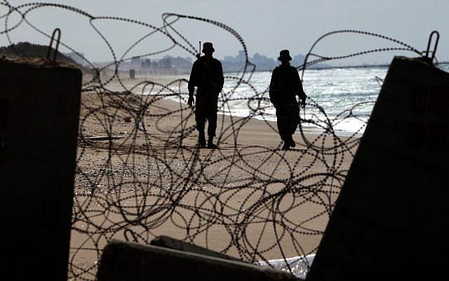 Israeli soldiers along the Gaza border (illustrative photo credit: Tsafrir Abayov/Flash90)