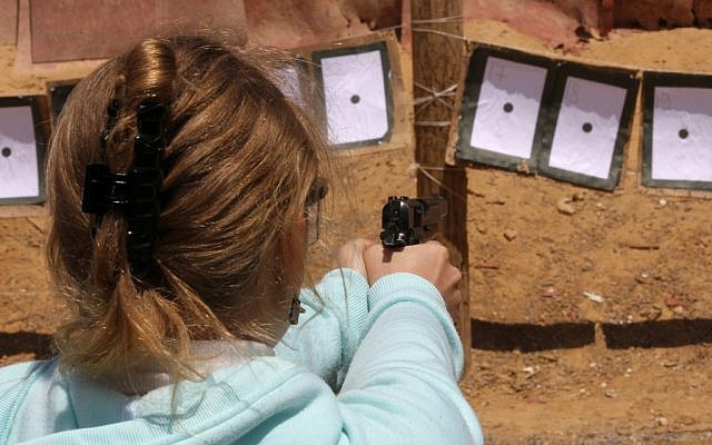 A girl shooting a pistol at a shooting range in Gush Etzion in 2010 (photo credit: Nati Shohat/Flash90