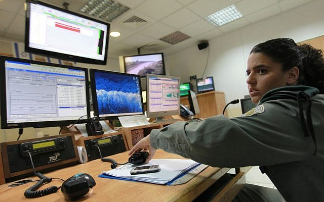 Illustrative. An Israeli soldier in front of computer monitors. (Nati Shohat/Flash90)