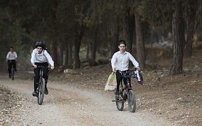 Young orthodox Jewish boys ride their bicycles in the forest near Modi'in Illit. (Nati Shohat/FLASH90)