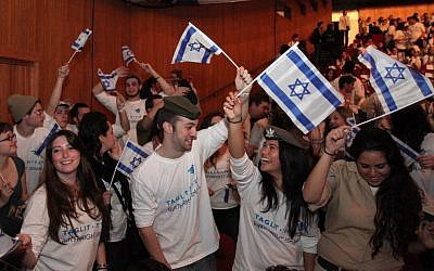 Young Diaspora Jews participating in a Taglit Birthright event at the International Conference Center in Jerusalem in January, 2012. (photo credit: Marc Israel Sellem/Flash90)
